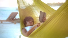 Woman on hammock with tablet Stock Footage