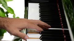 Musician hands playing the piano Stock Footage