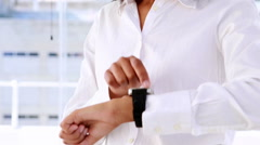 Businesswoman smiling and using a smart watch Stock Footage
