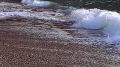Great ocean waves on a pebbly beach Stock Footage