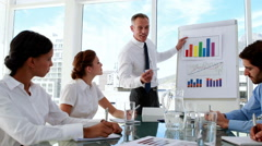 Business manager presenting data to his staff Stock Footage