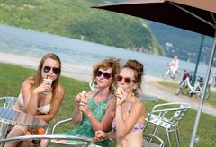 Three young women make tourism in france Stock Photos