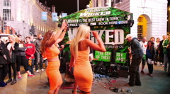 Street band at Picadilly Circus and blondes Stock Footage