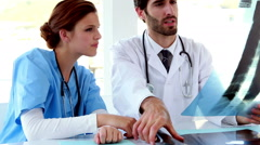 Medical team looking at x-ray together Stock Footage