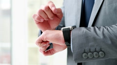 Businessman using his smart watch - stock footage