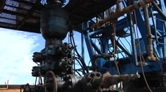 Oil Well Head under drilling rig Stock Footage