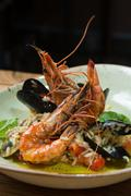 risotto with mussels, prawns and seafood - stock photo