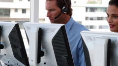 Happy call center employees at work - stock footage