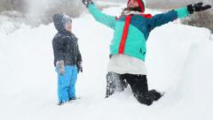 Mother and Son in Wintertime playing in snow Stock Footage