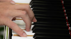 Hands playing piano Stock Footage