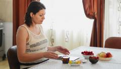Pregnant woman using a tablet Stock Footage