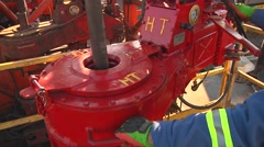 Drilling Rig running power tongs - stock footage