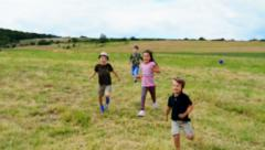 Funny kids running at race - stock footage
