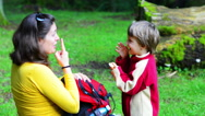 Stock Video Footage of Mother and son singing in the forest, the son imitates his mothe