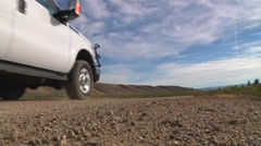 Pick up truck on gravel road Stock Footage