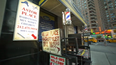 Astor Place famous Barber Shop for haircuts in New York City, Manhattan, NY, USA Stock Footage