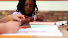 Little girl colouring in the classroom Stock Footage