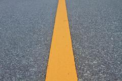 Asphalt road with marking lines and tire tracks Kuvituskuvat