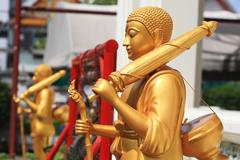pilgrim golden buddha statues - stock photo