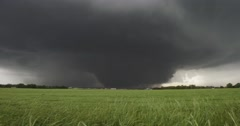 4K Very large tornado beyond farmland. Stock Footage