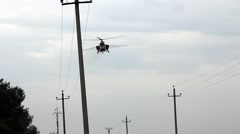 Helicopter spraying fertilizer on a crop Stock Footage