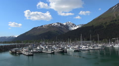 Sailing boats in port of Seward, Alaska - blue sky and mountains background Stock Footage
