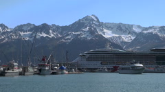 Cruise ship in port of Seward, Alaska - snowy mountains background Stock Footage
