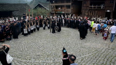 The Miao people and the visitors dance together for fun Stock Footage