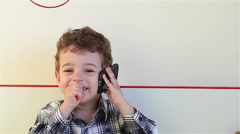 Laughing little boy talking on smartphone Stock Footage