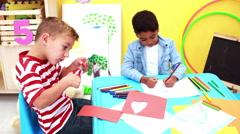 Cute little boys having art time in the classroom - stock footage