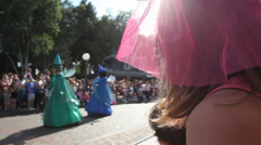 Girl greeting fairies at parade - stock footage