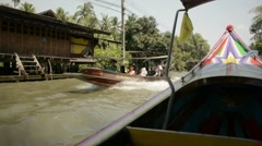 Tourist long-tail boat tours to the floating market Stock Footage