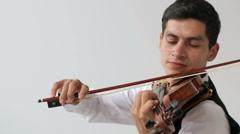 Latino violinist man on a white background. Medium shot. Stock Footage