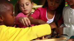 Preschool class learning how to play chess Stock Footage