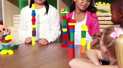 Cute classmates playing with building blocks - stock footage