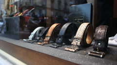 Male belts in boutique shop Stock Footage