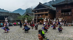 The Miao people dance before their house for the show Stock Footage