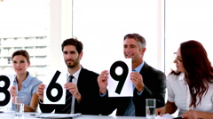 Business people on interview panel showing scores Stock Footage