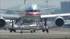 Small plane and Jetliner Stock Footage