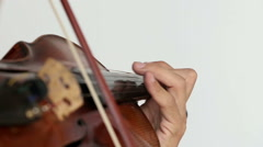 Violinist man playing the violin on a white background. Close up. Stock Footage
