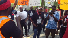 Africans protest against government corruption - stock footage