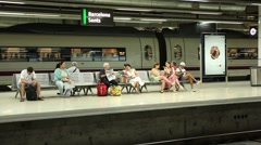 People waiting for train at underground platform Stock Footage