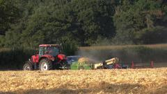 Agriculture farming tractor and machinery producing straw bales Stock Footage