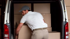 Delivery driver unloading his van Stock Footage