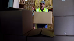 Delivery driver loading his van with boxes Stock Footage