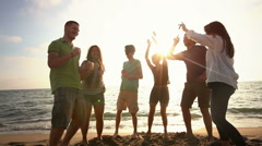 Stock Video Footage of Multiracial Group Dancing at Beach