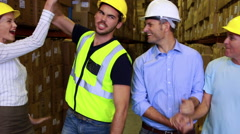 Warehouse team smiling and high fiving each other Stock Footage