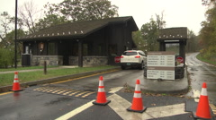 Ranger station car enters blue ridge parkway Stock Footage