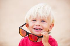 little boy at the beach - stock photo