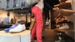 Couple buying shoes Stock Footage